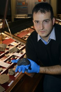 Meteorite scientist, Ludovic Ferrière at the Natural History Museum in Vienna, Austria, holds a chunk of Chelyabinsk skyfall.   Credit: © NHM Wien, Kurt Kracher. Used with permission.