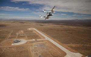 Virgin Galactic's WhiteKnightTwo/SpaceShipTwo launch system flies above New Mexico's Spaceport America. Credit: Virgin Galactic/Mark Greenberg