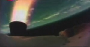 A screen shot shows the LDSD test vehicle after it dropped from the balloon that lifted it to high altitudes and fired its rocket. The picture was taken by a low-resolution camera onboard the vehicle. Earth is the blue-green orb in the background. Image Credit: NASA/JPL-Caltech