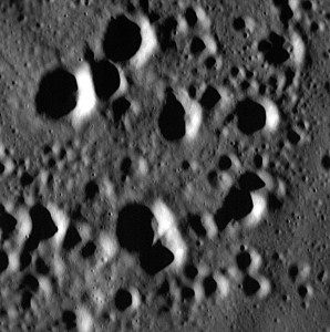 This image is one of the highest resolution images taken to date by the MESSENGER spacecraft. It features a field of secondary craters in Mercury's northern smooth plains. Secondary craters are formed by the re-impact of debris strewn from a larger crater. The largest secondary craters in this image are roughly a few hundred meters across. If you look closely, you can see some small craters that are only tens of meters across. Credit: NASA/Johns Hopkins University Applied Physics Laboratory/Carnegie Institution of Washington