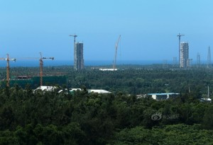 China's Hainan launching site is approaching operational status. Early work on China's newest spaceport is shown here in full swing with rocket assembly towers in view. Credit: China Space Website