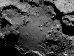 The group of boulders in the center of this image reminded scientists of the Giza Necropolis. The largest boulder has therefore been named Cheops.  Credit: ESA/Rosetta/MPS for OSIRIS Team MPS/UPD/LAM/IAA/SSO/INTA/UPM/DASP/IDA