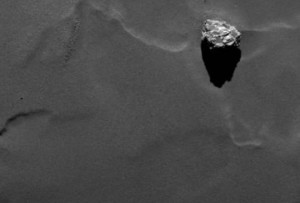 Close-up of the boulder Cheops as it casts a long shadow on the surface of comet 67P/Churyumov-Gerasimenko. Cheops has a size of approximately 45 meters and is the largest structure within an a group of boulders located on the lower side of the comet's larger lobe.  Credit: ESA/Rosetta/MPS for OSIRIS Team MPS/UPD/LAM/IAA/SSO/INTA/UPM/DASP/IDA
