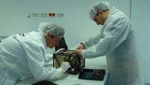 Mobile Asteroid Surface Scout, or MASCOT, is prepared by engineers at the  German Aerospace Center (Deutsches Zentrum für Luft- und Raumfahrt; DLR). Credit: DLR