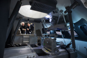 Ted Cruz, Republican senator from Texas, poked his head into NASA's Orion last year at the Johnson Space Center. Orion program manager Mark Geyer (left) discusses the workings of the spacecraft with the lawmaker. Credit: Lockheed Martin