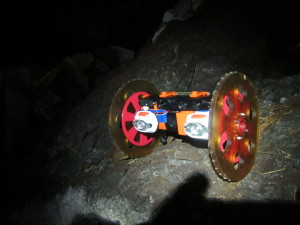 VolcanoBot 1, shown here in a lava tube -- a structure formed by lava -- explored the Kilauea volcano in Hawaii in May 2014. The robot is enabling researchers at NASA's Jet Propulsion Laboratory to put together a 3-D map of the fissure. Image Credit: NASA/JPL-Caltech