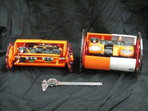 Two robots designed to explore volcanoes are pictured here. VolcanoBot 1 (right) has a length of 12 inches (30 centimeters) and 6.7-inch (17-centimeter) wheels. VolcanoBot 2 (left) is smaller, as it is 10 inches (25 centimeters) long and has 5 inch (12 centimeter) wheels.  Image Credit: NASA/JPL-Caltech
