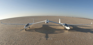 The one-third-scale twin fuselage towed glider rests on the Rogers Dry Lake at Edwards Air Force Base prior to its first flight Oct. 21, 2014 in this photo shot with a 16-mm. fisheye lens. Credit: NASA Armstrong/Tom Tschida