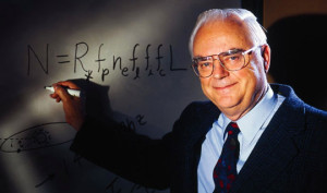 Frank Drake with cosmic equation to gauge the presence of intelligent life in the cosmos. The Drake Equation identifies specific factors believed to play a role in the development of civilizations in our galaxy. Credit: SETI Institute