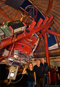 Frank Drake, center, with his colleagues, Optical SETI (OSETI) Principal Investigator Shelley Wright and Rem Stone with the 40-inch Nickel telescope at Lick Observatory in California. Outfitted with the OSETI instrument, the silver rectangular instrument package protrudes from the bottom of the telescope, plus computers, etc.  Credit: Laurie Hatch Photography, used with permission