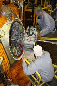 Bion-M1 Russian flight hardware for bioscience research is placed aboard the Bion recoverable module by Cosmodrome staff in Baikonur, Kazakhstan.  Cedit: Russian Federal Space Agency (Roscosmos)