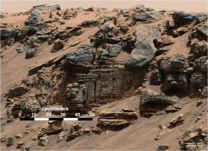 The image is from 'Hidden Valley' in Gale Crater on Mars. Very fine-grained sediments, which slowly fell down through the water, were deposited right at the bottom of the crater lake. The sediment plates at the bottom are level, so everything indicates that the entire Gale Crater may have been a large lake.  Credit: NASA/JPL, MSSS