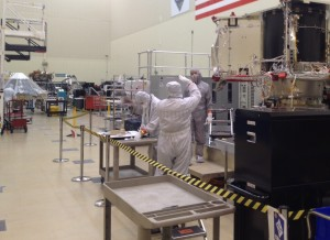 Busy builders of spacecraft missions. Lockheed Martin technicians are readying asteroid mission in a large ultra-clean room (foreground) as workers prepare the Insight Mars lander -- in background -- that will head for the Red Planet in 2016.  Credit: Leonard David/Inside Outer Space