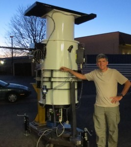 Astro-technologist, John Tonry, with nearly-complete ATLAS 1 telescope at Colorado-based DFM Engineering in late March. Credit: ATLAS Project