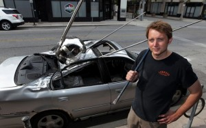 Sputnik 1 embedded into auto. Artist Brandon Vickerd with his clash/crash of cultures.  Photo courtesy: Artcite/Nick Brancaccio/The Windsor Star