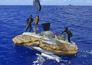 Sailors assigned to the Explosive Ordnance Detachment of Mobile Diving and Salvage Unit 1 recover the test vehicle for NASA's Low-Density Supersonic Decelerator (LDSD) off the coast of the U.S. Navy's Pacific Missile Range Facility in Kauai, Hawaii. NASA's LDSD project is designed to investigate and test breakthrough technologies for landing future robotic and human Mars missions, and safely returning large payloads to Earth.  Credit: U.S. Navy photo by Chief Mass Communication Specialist John M. Hageman