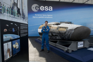 ESA astronaut Thomas Pesquet and the IXV in front of the ESA Pavilion, at Paris Air and Space Show, on June 16, 2015. Pesquet has been assigned to a long-duration mission on the International Space Station. He will be leaving our planet for six months November 2016 as a flight engineer for Expeditions 50 and 51, returning in May 2017. Credit: ESA–CB PROD, 2015