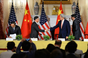 Secretary of State John Kerry shakes hands with Chinese Vice Premier Wang Yang after they delivered closing statements at the conclusion of the U.S.-China Strategic and Economic Dialogue (S&ED) / Consultation on People-to-People Exchange (CPE) at the U.S. Department of State in Washington, DC. Credit: State Dept Image /June 24, 2015