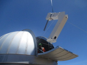 The mount for the Haleakala observatory is lifted into the dome. Credit: ATLAS team