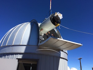 ATLAS#1 telescope gently lowered into Haleakala observatory. Credit: ATLAS team