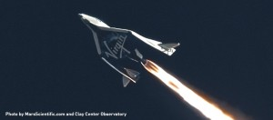 Virgin Galactic's SpaceShipTwo is shown making a rocket-powered test flight on Jan. 10, 2014. The vehicle crashed during a subsequent rocket-powered test flight on Oct. 31, 2014, killing one pilot and injuring the other. Credit: MarsScientific.com/Clay Center Observatory