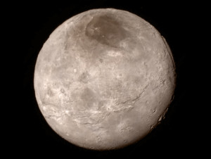 New details of Pluto's largest moon Charon show it with a swath of cliffs and troughs stretches about 600 miles (1,000 kilometers). Credit: NASA-JHUAPL-SwRI
