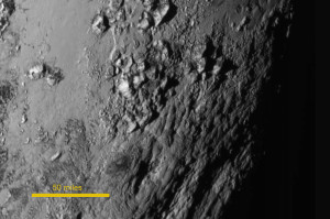 New Horizons image of Pluto's equator released today shows a range of youthful mountains rising as high as 11,000 feet (3,500 meters) above the surface of the icy body. Credit: NASA-JHUAPL-SwRI