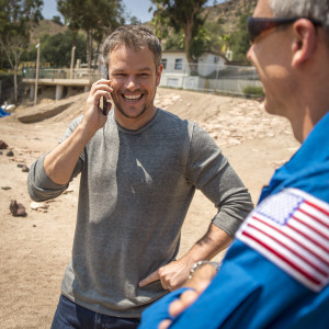 "Actor Matt Damon, who stars as NASA Astronaut Mark Watney in the film ""The Martian,"" talks on the phone with NASA Astronauts Scott Kelly and Kjell Lindgren who are onboard the International Space Station (ISS), while NASA Astronaut Drew Feustel looks on, Tuesday, Aug. 18, 2015, at the Jet Propulsion Laboratory in Pasadena, California. Credit: Bill Ingalls/NASA"