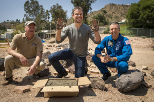 "Actor Matt Damon, who stars as NASA Astronaut Mark Watney in the film ""The Martian,"" smiles after having made his hand prints in cement at the Jet Propulsion Laboratory (JPL) Mars Yard, while Mars Science Lab Project Manager Jim Erickson, left, and NASA Astronaut Drew Feustel look on, Tuesday, Aug. 18, 2015, at the JPL in Pasadena, California.  Credit: NASA/Bill Ingalls"