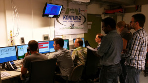 While cosmonaut Oleg Kononenko in the International Space Station uses the Kontur-2 joystick to control the ROKVISS robot on the ground, researchers at the German Aerospace Center (Deutsches Zentrum für Luft- und Raumfahrt; DLR) monitor and supervise the contact and give instructions. Credit: DLR