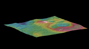 This view, made using images taken by NASA's Dawn spacecraft, features a tall conical mountain on Ceres.  Elevations span a range of about 5 miles (8 kilometers) from the lowest places in this region to the highest terrains. Blue represents the lowest elevation, and brown is the highest. The white streaks seen running down the side of the mountain are especially bright parts of the surface. Credit: NASA/JPL-Caltech/UCLA/MPS/DLR/IDA/PSI