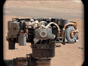 This 2012 image shows the Alpha Particle X-Ray Spectrometer (APXS) in center onboard NASA's Curiosity rover, with the Martian landscape in the background. Credit: NASA/JPL-Caltech/MSSS