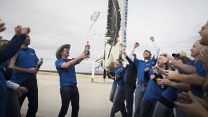 The Blue Origin team celebrates with founder Jeff Bezos at the site of the New Shepard rocket booster landing. Credit: Blue Origin
