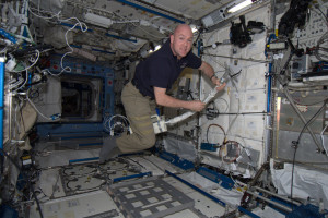 Flying on a vacuum cleaner. Every Saturday, ISS astronauts vacuum the filters and clean all surfaces. Credit: ESA/NASA