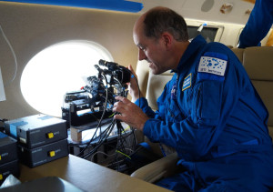 The instrument teams onboard the aircraft are intent on observing the entry. Credit: IAC/UAE Space Agency/NASA/ESA)