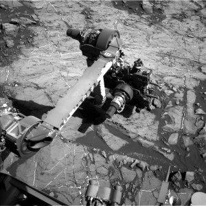 Curiosity's robotic arm busy at work, shown in this Navcam Left B image, taken on Sol 1198 December 20, 2015. Credit: NASA/JPL-Caltech