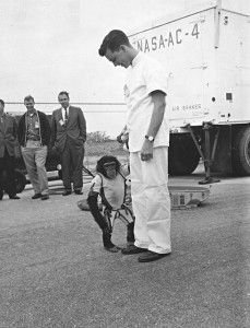 U.S. Mercury program's Ham, the first chimpanzee ever to ride into space in January 1961 is shown off by his animal trainer at Cape Canaveral, Florida. Credit: NASA/KSC