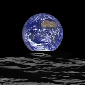 The Earth straddling the limb of the Moon, as seen from above Compton crater. Center of the Earth in this view is 4.04°N, 12.44°W, just off the coast of Liberia. The large tan area in the upper right is the Sahara desert, and just beyond is Saudia Arabia. The Atlantic and Pacific coasts of South America are visible to the left. Credit: NASA/GSFC/Arizona State University