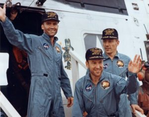 Fred Haise (left), Jim Lovell, and Jack Swigert emerge from the recovery helicopter on-board the aircraft carrier Iwo Jima on April 17, 1970. Credit Scan by Ed Hengeveld from Eric M. Jones Apollo 13 Image Library.