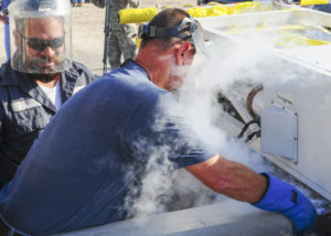 Technicians from the 846th Test Squadron at Holloman Air Force Base, N.M., pump liquid helium into a test sled here Aug. 18, 2015. This sled system runs on four super-conducting magnets that need to be cooled down to a few degrees above absolute zero to ensure the smoothest ride possible. Credit: U.S. Air Force photo by Airman 1st Class Randahl J. Jenson