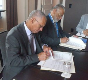 NASA Administrator Charles Bolden (left) and Chairman K. Radhakrishnan of the Indian Space Research Organisation signing documents in Toronto on Sept. 30, 2014 that included establishing a pathway for future joint missions to explore Mars. Credit: NASA