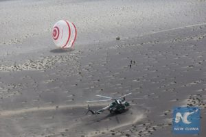 China's prototype reentry module has parachuted to a landing in Badain Jaran Desert in north China. Credit: New China