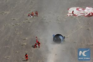 Recovery operations for test capsule. Credit: New China