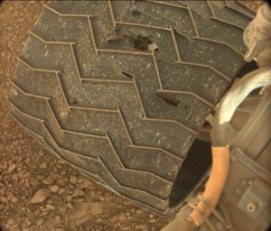 Curiosity Mastcam Left image of rover wheel damage, taken on Sol 1403 July 17, 2016. Credit: NASA/JPL-Caltech/MSSS
