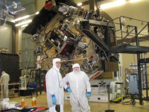 Juno spacecraft is being prepped for Jupiter at Lockheed Martin Space Systems. Bunny-suited Jack Farmerie, (left) Lockheed Martin's lead spacecraft technician on the Juno project (left) and SPACE.com reporter Leonard David (right). Credit: Gary Napier