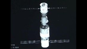 Deployed micro-satellite is monitoring the combined Tiangong-2/Shenzhou-11 vehicles. Credit: CCTV
