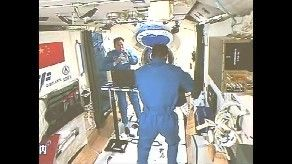 China space travelers, Jing Haipeng and Chen Dong, onboard Tiangong-2 space lab. Credit: CCTV
