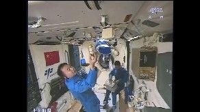 Inside Tiangong-2 as crew members carry out experiments. Credit: CCTV