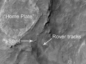"Image shows the location of Spirit rover on September 29, 2006. Toward the top of the image is ""Home Plate,"" a plateau of layered rocks that Spirit explored during the early part of its third year on Mars. Spirit itself is clearly seen just southeast of Home Plate. Also visible are the tracks made by the rover. Image was taken by the Mars Reconnaissance Orbiter's HiRISE instrument. Credit: NASA/JPL-Caltech/University of Arizona"