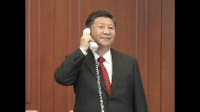 General Secretary of the Communist Party of China (CPC) Central Committee Xi Jinping -- also Chinese president and chairman of the Central Military Commission -- called the two astronauts aboard the Tiangong-2 space lab from the command center of China's manned space program. Credit: CCTV-Plus